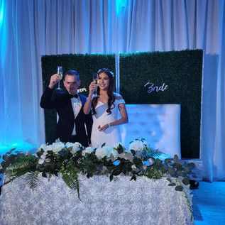 couple toasting at wedding in banquet hall