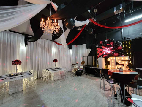 Elegant banquet hall decorated in black and red