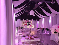 Banquet hall with pink lights decoration
