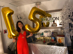 girl with balloons 15 years at birthday party