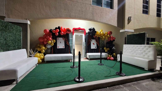 Event venue entrance decorated with a balloon arrangement