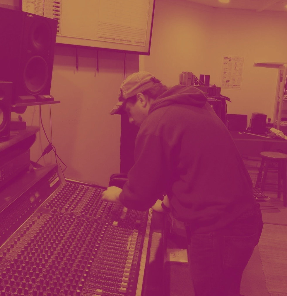 ZTF Studio -Zach standing at mixing console