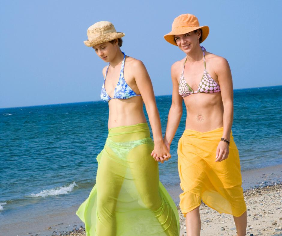Lesbian Couple walking the beach