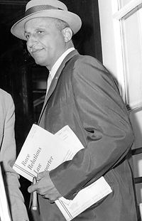 Hill entering the Alexandria, Virginia, courthouse in 1958.