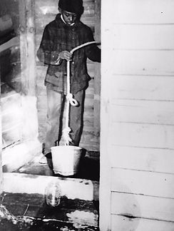Student drawing water from well at Gloucester County Training School