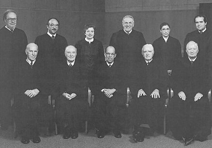 Robinson sits, as chief judge, with the US Court of Appeals for the DC Circuit, 1982-83 term.  Prominent jurists Robert H. Bork, Ruth Bader Ginsburg, and Antonin Scalia are in the second row.