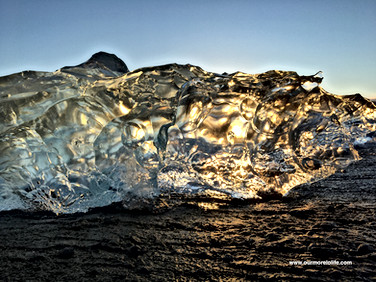 Amazing small iceberg with dawns first sunlight
