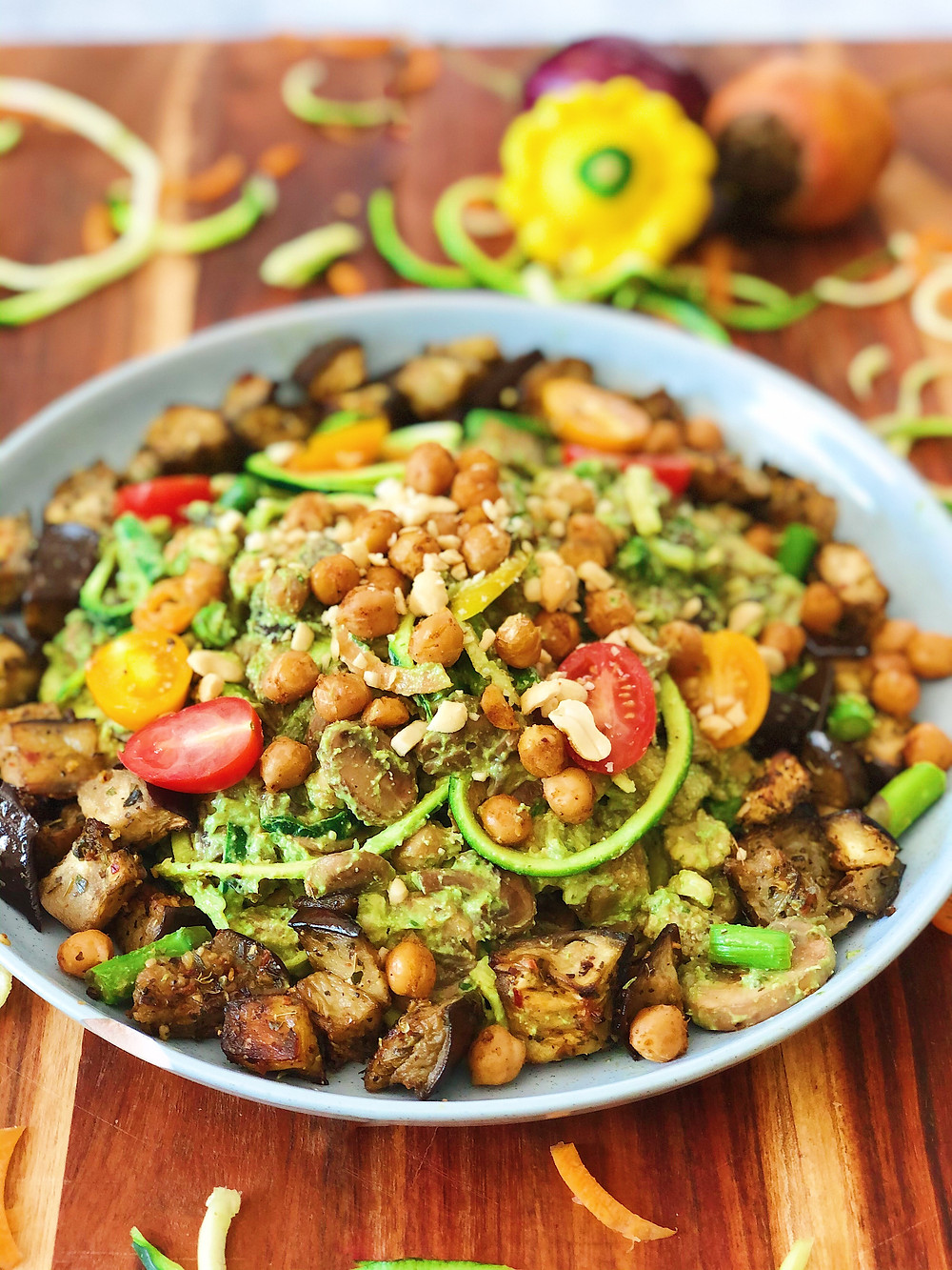 Vegan zoodle (zucchini noodles) with avocado pesto, eggplant, chickpeas and veggies