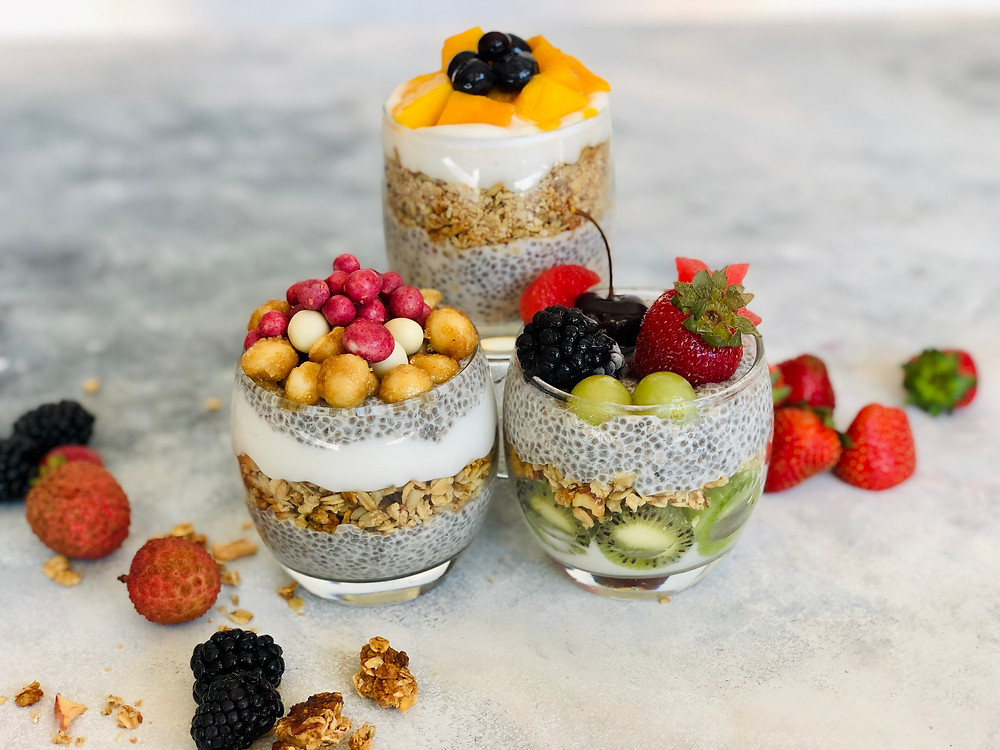 3 cups layered with chia pudding, coconut yoghurt, granola, coated nuts and fruits