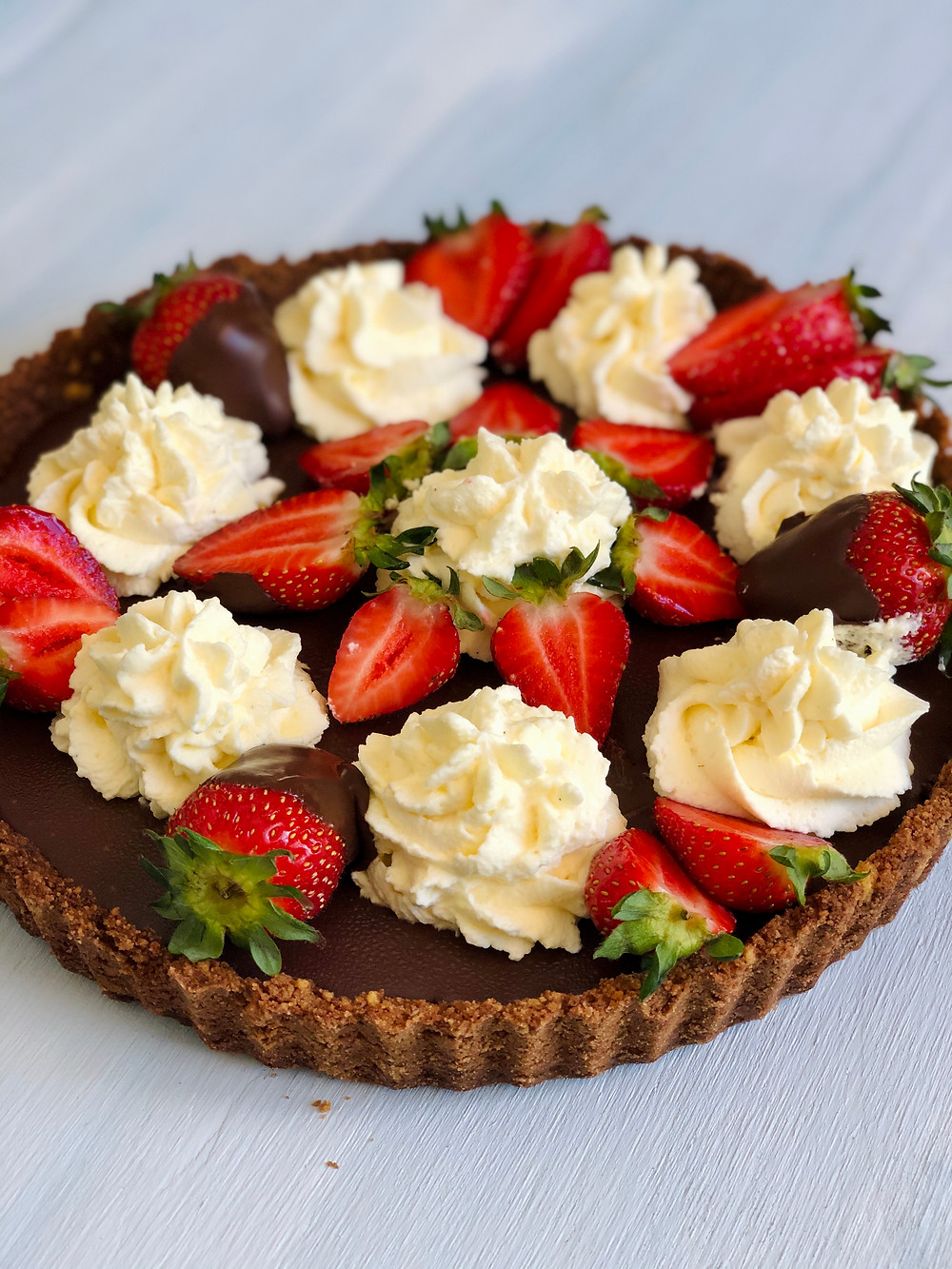 Chocolate  pie with fresh strawberries and whipped cream on top