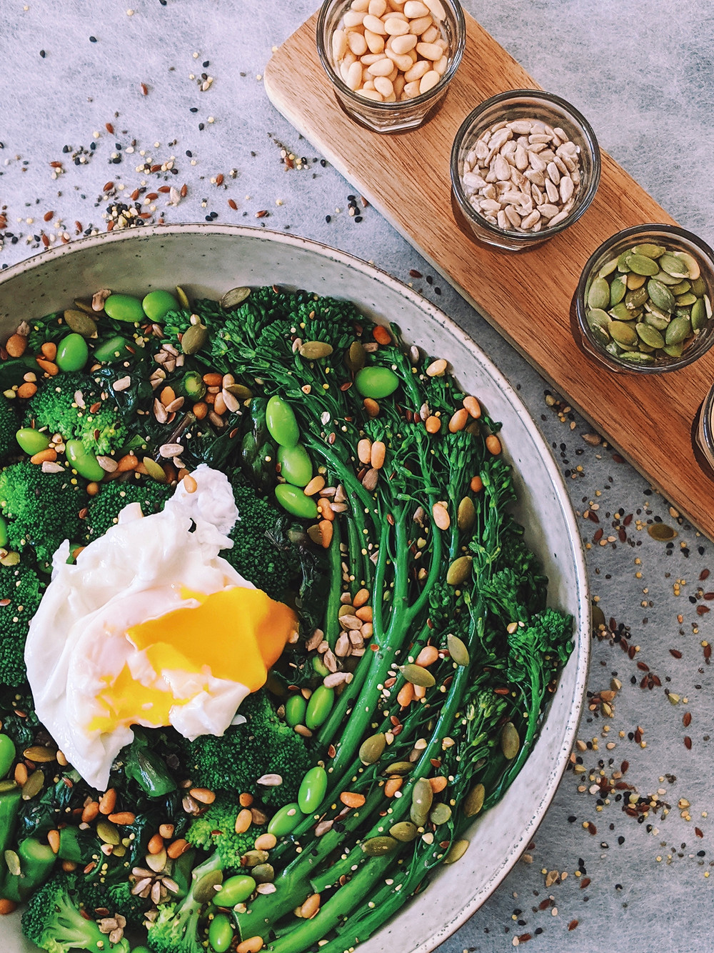 Healthy bowl full with greens and nuts, topped with Tahini sauce,  perfect for breakfast and lunch