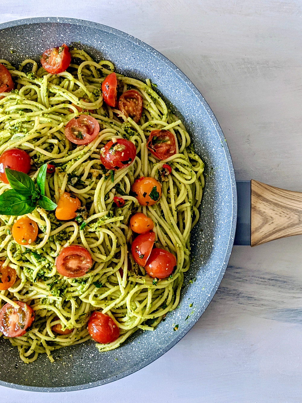 pasta with pea pesto sauce and cherry tomatoes