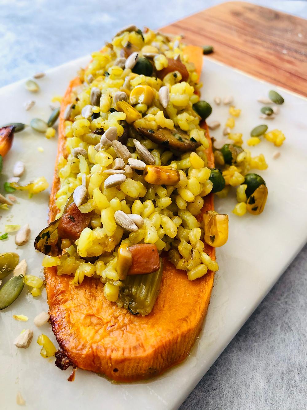 Yellow rice with veggies on sweet potatoes