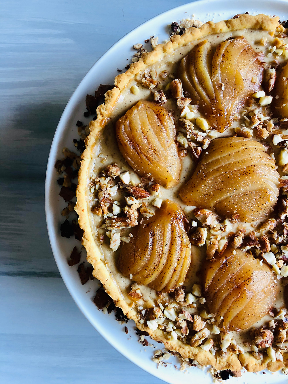 close up ricotta and poached pear pie with cinnamon