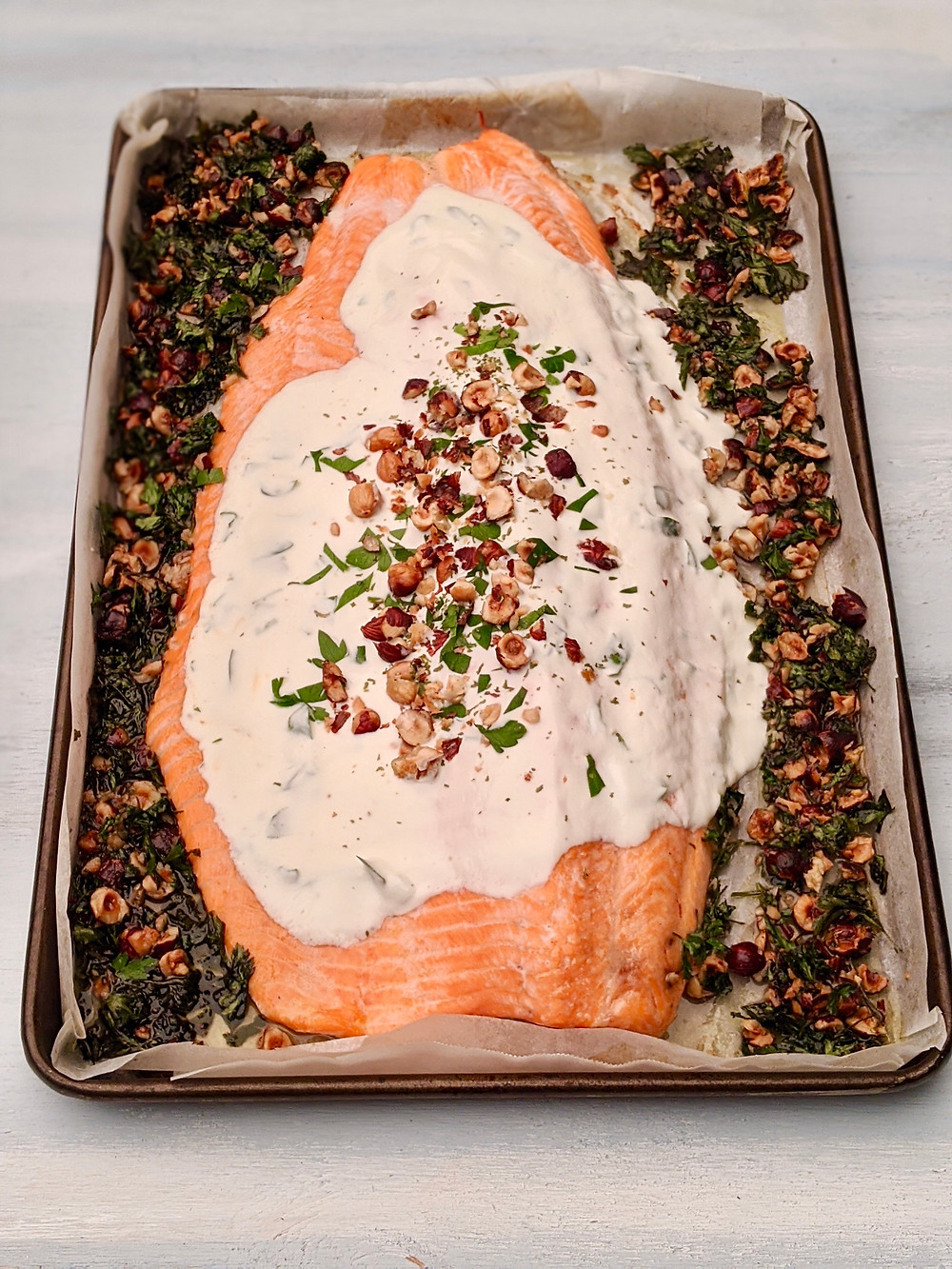 Rainbow trout fillet in the over with yogurt hazelnut dressing