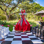 Queen's Playing Giant Chess, Wonderland Wonderful Experience, Giant Chess Board at the Party, CIRCUS PICNIC Themed Party Ideas, Texas