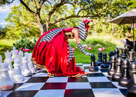 The Queen on The Giant Chess, Party Entertainers, Giant Chess board Encounter at Circus Style Corporate Event, CIRCUS PICNIC Artistic Event Idea