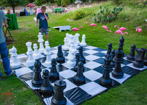 Guests Playing Giant Chess, Wonderland Extraordinary Game Experience at CIRCUS PICNIC Corporate Event Texas