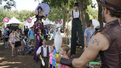 Surrounded by Circus Artist, Party Stilt Walkers Jugglers, Entertainers, Performers at Circus Styled Party in Austin City Limits, T X