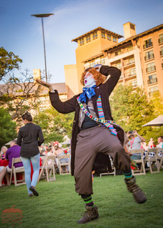 Mad Hatter Throwing Plates, Wonderland Cast, Entertainers, Performers at Company Party, CIRCUS PICNIC Wonderland Theme Party Ideas, Texas