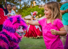 Playful Cheshire Cat, Lovely Guest Playing With Wonderland Cheshire Cat, CIRCUS PICNIC Themed Corporate Party Texas