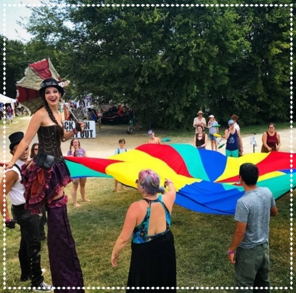 Experiencing the Joy of a Rainbow Parachute Lifting Activity  at Art Outside Festival