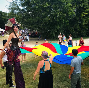 The Parachutes Challenge, Party Goers in Parachutes lifting Challenge at Austin City Limits Circus Theme Party, CIRCUS PICNIC Theme Party Ideas, Austin Texas