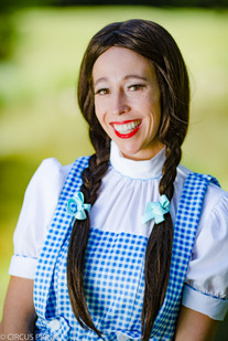 Dorthy is posing for a picture at a CIRCUS PICNIC party
