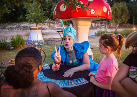 Guest and Caterpillar on Table, Fortune Telling Activity at CIRCUS PICNIC Creative Event Concept. Texas
