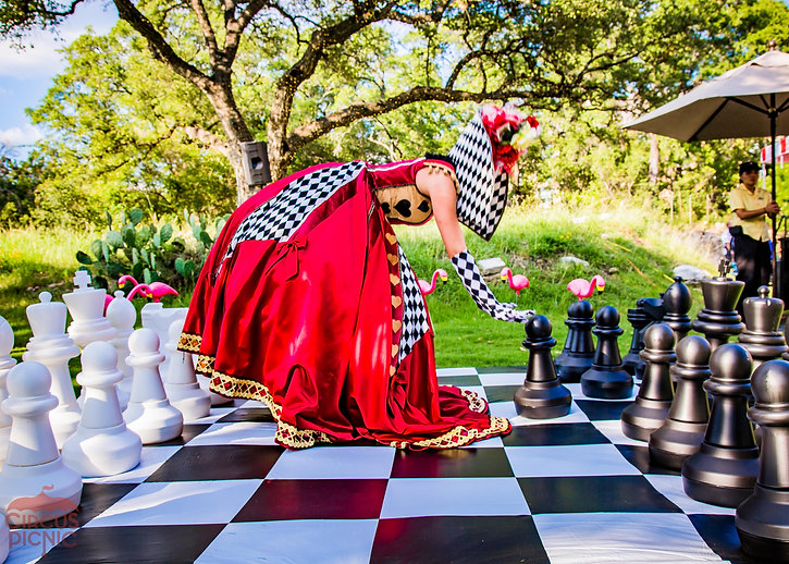 CIRCUS PICNIC Wonderland Themed Party, Queen of Hearts plays giant chess at a corporate picnic