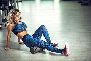 Attractive female doing foam roller exer