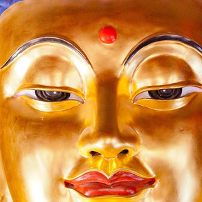 Why are Buddha's eyes half open?