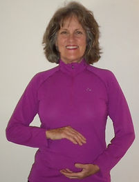 Judy Cameron demonstrating a Qigong movement