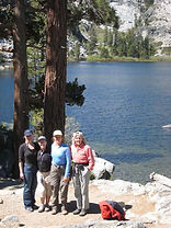 Attractive hiking group near a mountain lake