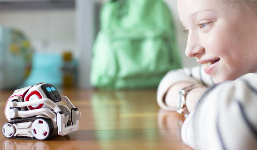 A child looking at the Cozmo robot