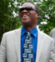 Marcus Roberts - laughing with fellow musicians (Jason Marsalis, Rodney Jordan, and Bela Fleck, in a park in Burlington, VT