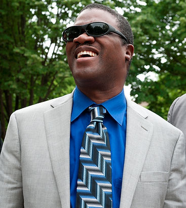 Marcus Roberts - laughing with fellow musicians (Jason Marsalis, Rodney Jordan, and Bela Fleck, in a park in Burlington, VT