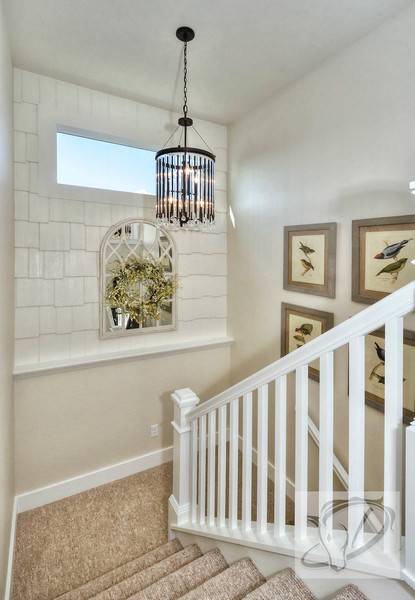 Shake shingles add charm and character to a stairway wall