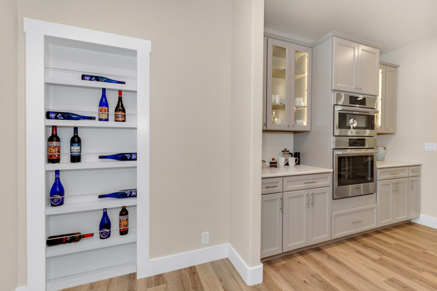 Wine storage just off of the kitchen is actually a secret door to the master closet, allowing easy access between the master and laundry room