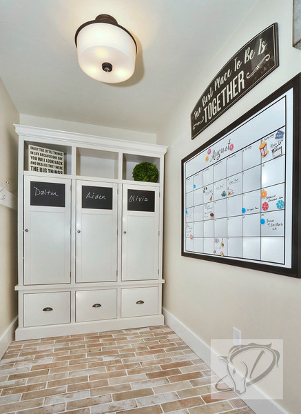 "Mudroom with lockers and ""brick"" tile floor"