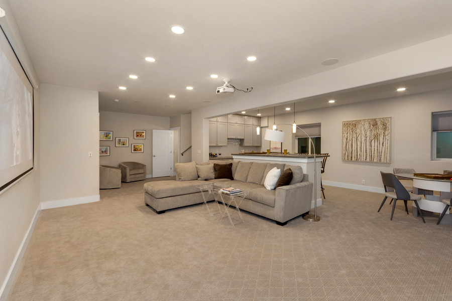 Basement family room with projection system, bar and game area