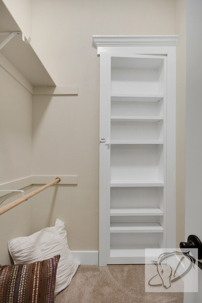 Teen girl's bedroom closet has secret door to a bunk room