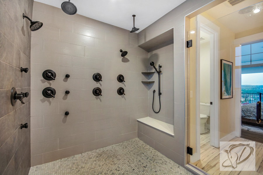 Euro wet room with multiple shower heads and free standing bath tub
