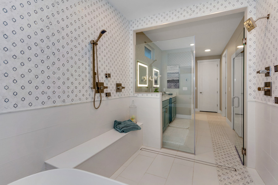 Master bath with Euro wet room. Dual shower heads and free standing bath tub