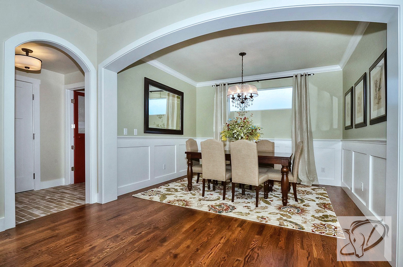 Dining room with classic oak floors, oil rubbed bronze and crystal chandelier and wainscoting. Dining table was purchased second hand to keep budget in check