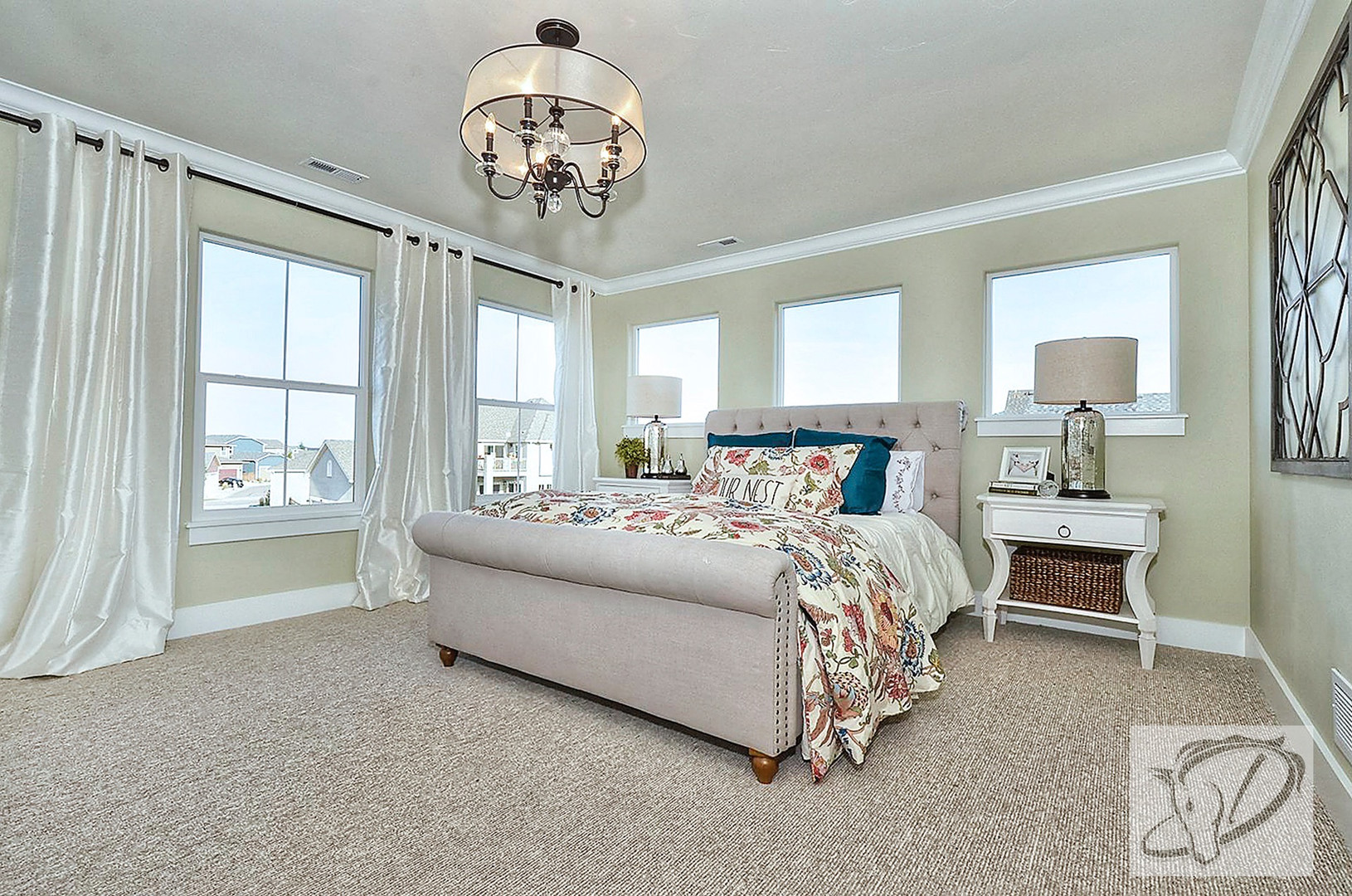 Light filled master bedroom with tufted upholstered bed