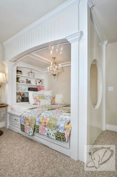 "Oh-so-sweet girl's room with custom ""princess"" bed complete with crystal chandelier."