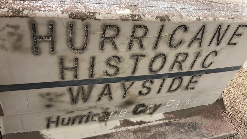 Masked concrete sign after blasting