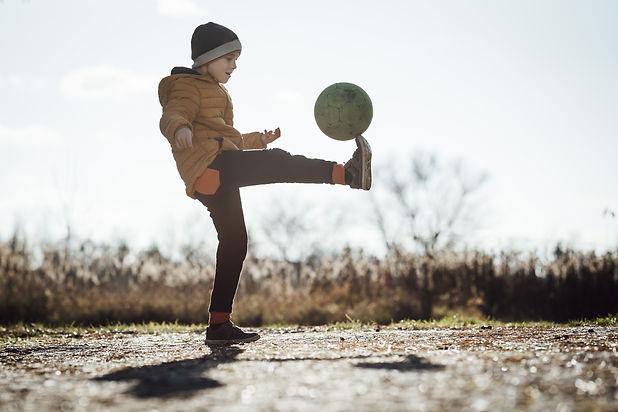 Child with Soccer Ball_AdobeStock_305244119.jpeg