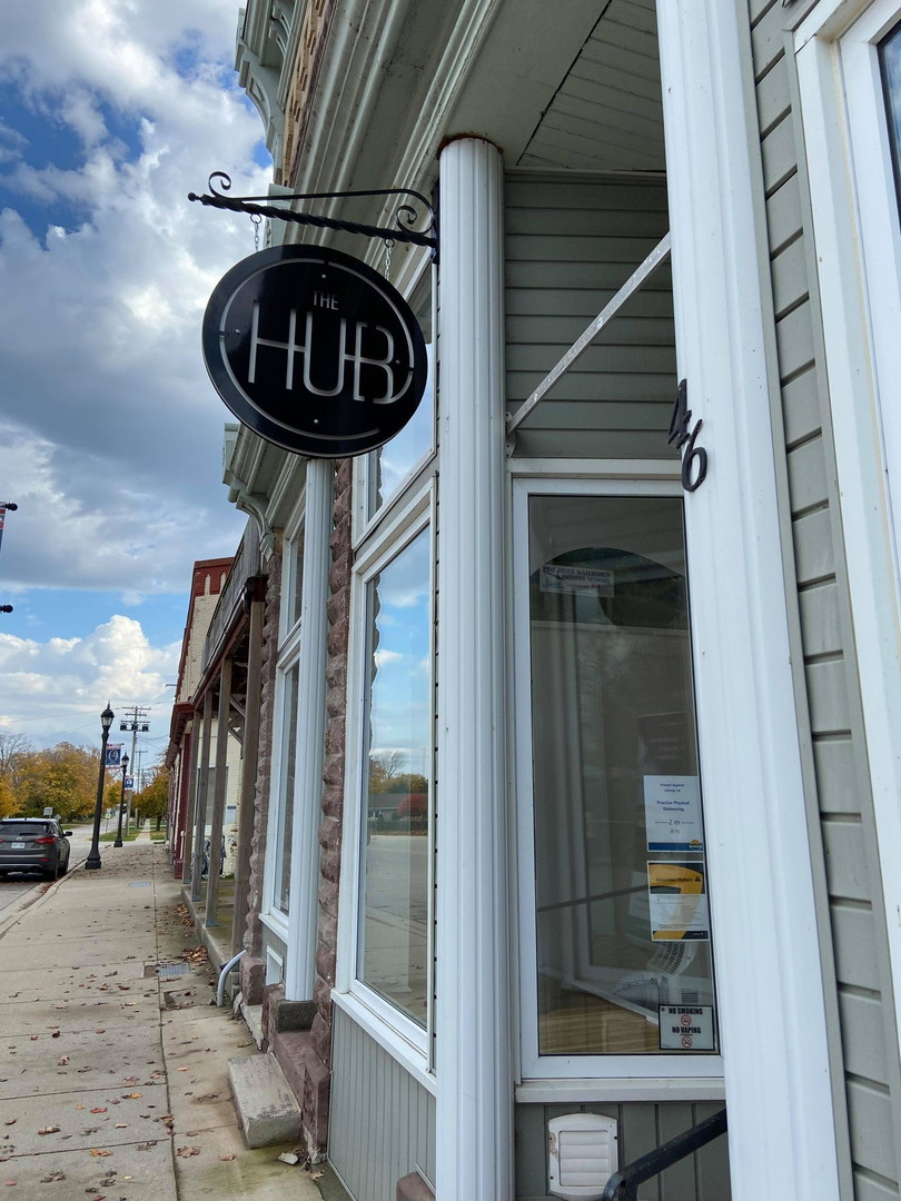 Outside and The Hub sign